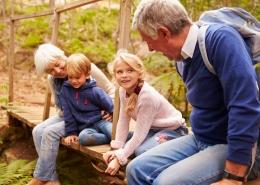 Sm grandparents sitting on bridge with grandkids copy